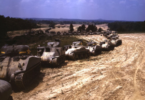 A parade of M-4 (General Sherman) and M-3 (General Grant) tanks in training maneuvers, at Ft. Knox, Kentucky. Note the lower design of the M-4, the larger gun in the turret and the two hatches in front of the turret. Photographed in June of 1942. (Alfred Palmer/OWI/LOC)