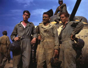 Tank crew standing in front of M-4 tank, Ft. Knox, Kentucky, June, 1942. (Alfred Palmer/OWI/LOC)